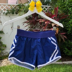 Blue Athletic Shorts with White Stripes